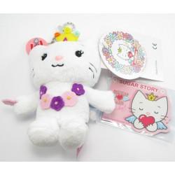 porte-clefs peluche d'angel cat sugar portant fleurs et collier
